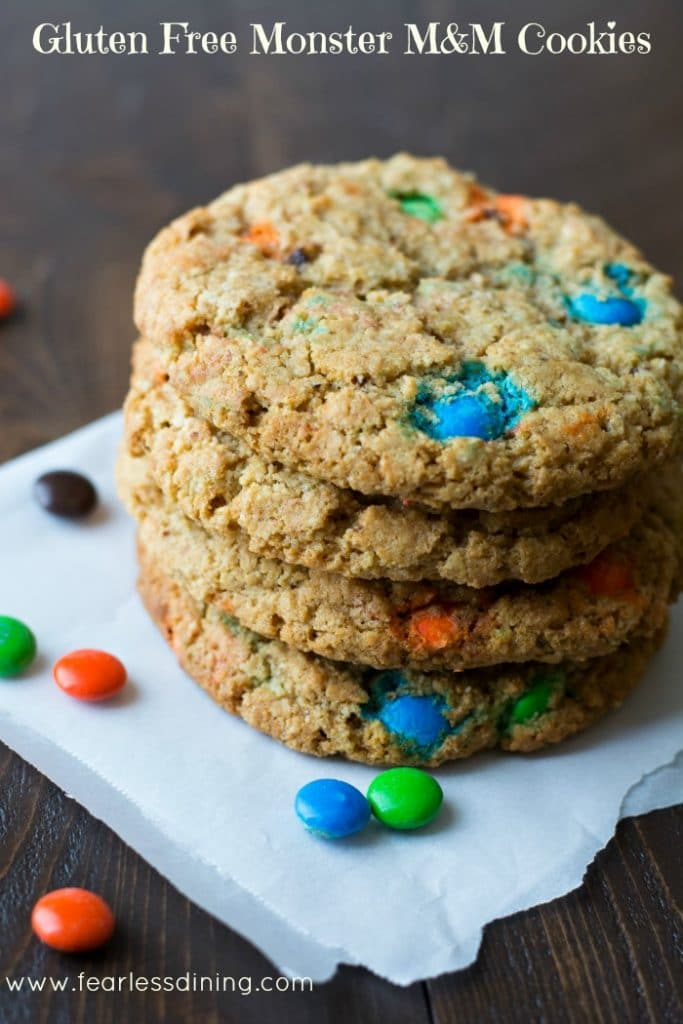 Gluten Free Monster M&M Cookies stacked on top of each other on a napkin