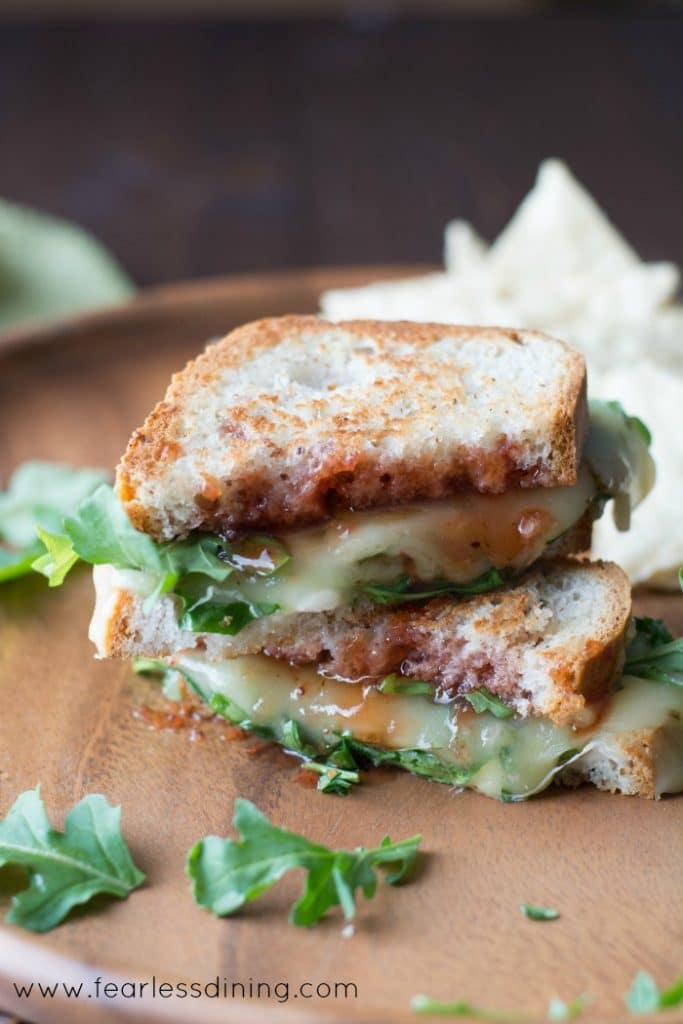 Grilled cheese sandwich on a plate with arugula