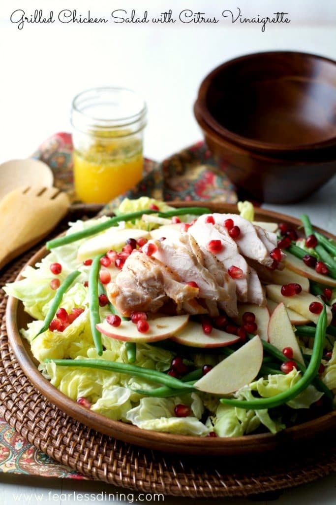 Grilled Chicken Salad with Citrus Vinaigrette is in a wooden bowl