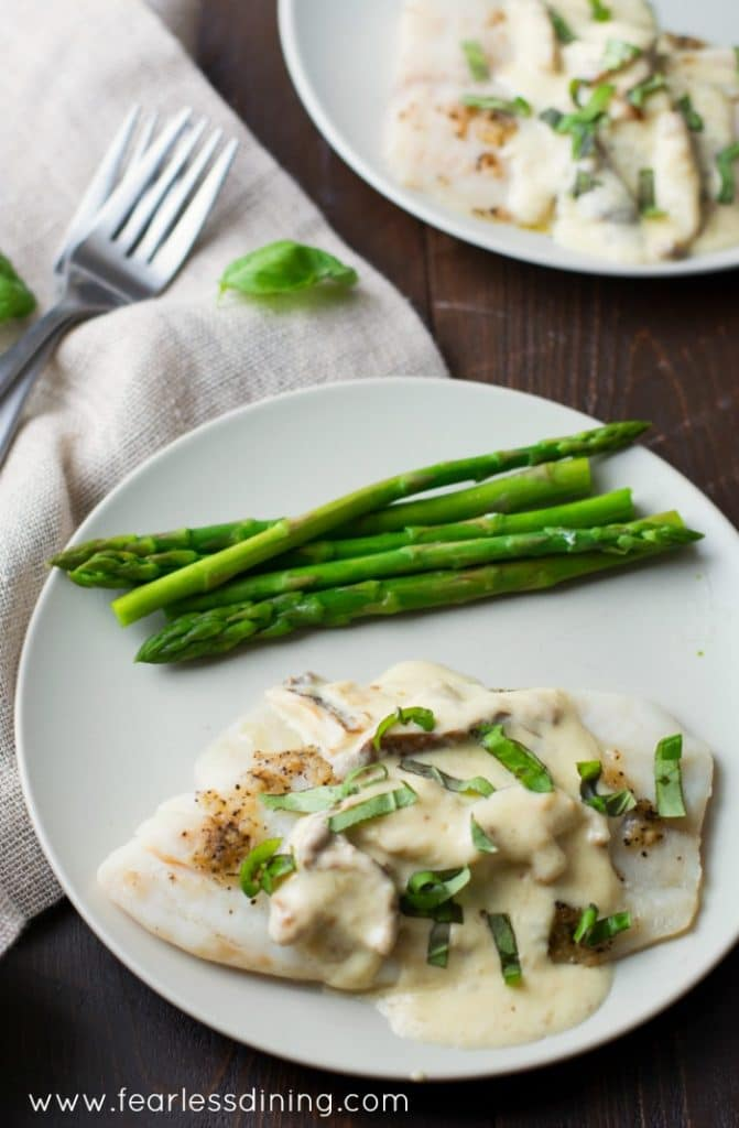 Tilapia with Alfredo Shiitake Sauce is a quick and easy dinner that is ready in just 20 minutes! Found at http://www.fearlessdining.com