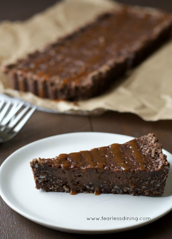 Gluten Free Chocolate Caramel Tart slice on a plate
