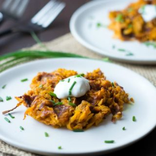 Curried Sweet Potato Hash Brown Waffles on plates with forks in the background