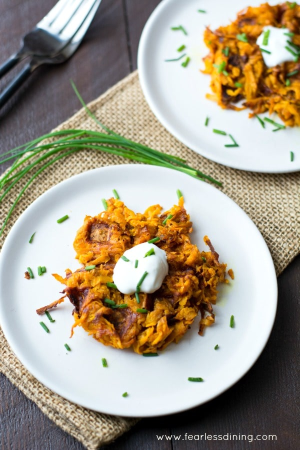 Top view of Curried Sweet Potato Hash Brown Waffles on white dinner plates