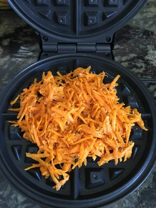 Sweet potato batter in waffle iron