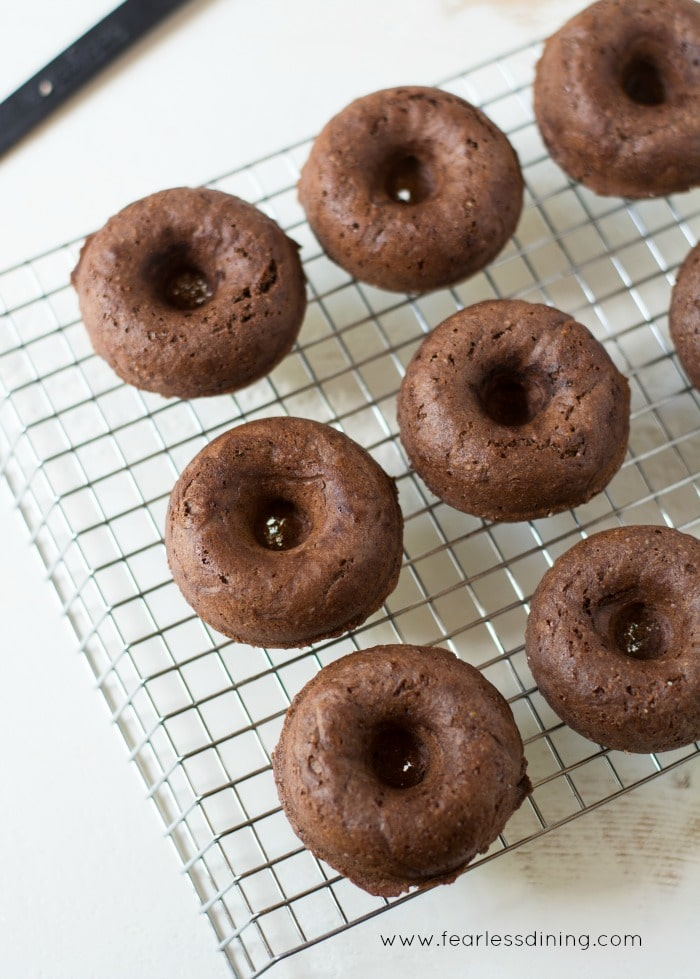 Gluten Free Chocolate Donuts on a cooling rack