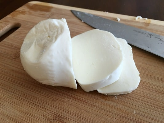 fresh mozzarella on a cutting board