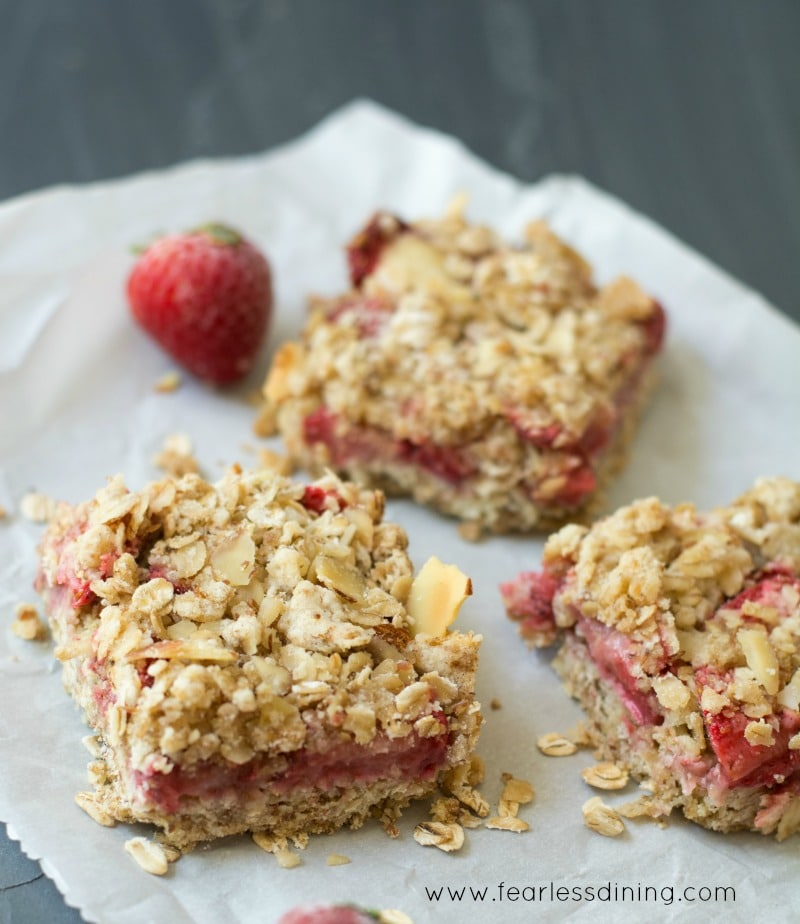 Simple Gluten Free Fresh Strawberry Oatmeal Bars on a piece of parchment paper