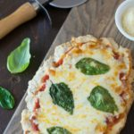gluten free flatbread pizza with fresh tomatoes and basil