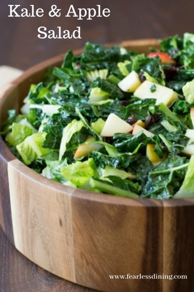 kale and apple salad in a wooden bowl