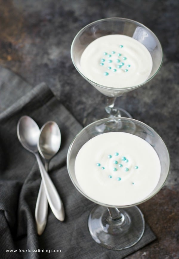 The top view of French Vanilla Mousse in martini glasses. Spoons are next to the glasses