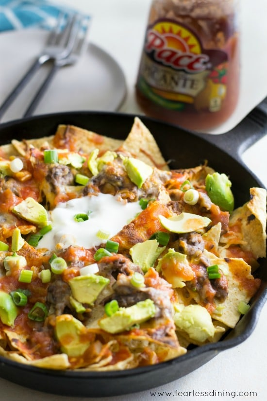 Black Bean Dip Skillet Nachos with a jar of salsa in the background