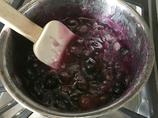 black grape pie filling in a pan