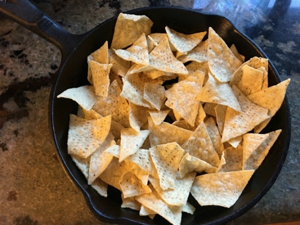 A cast iron skillet with tortilla chips