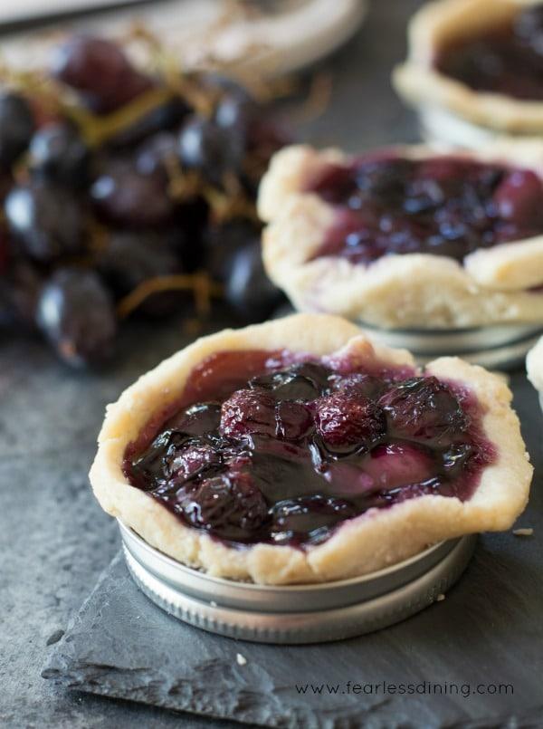 Easy Gluten Free Black Grape Mason Jar Lid Galettes in a row