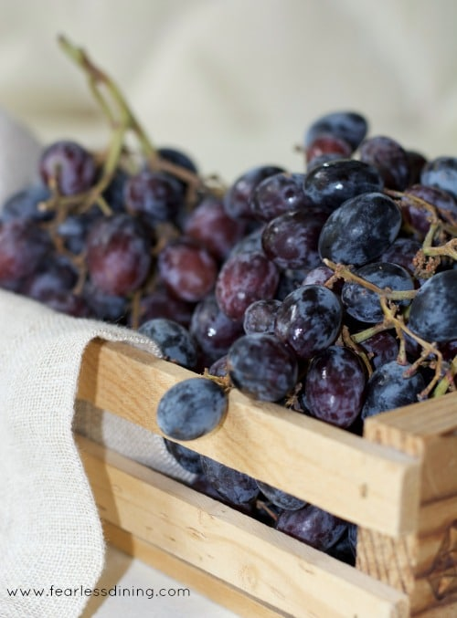 a basket filled with purple grapes