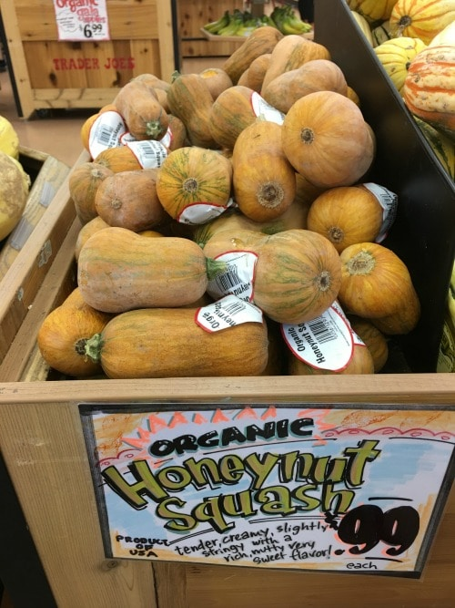 Honeynut squash in a bin at the market