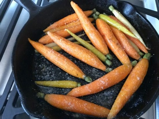 carrots cooking in a cast Iron skillet