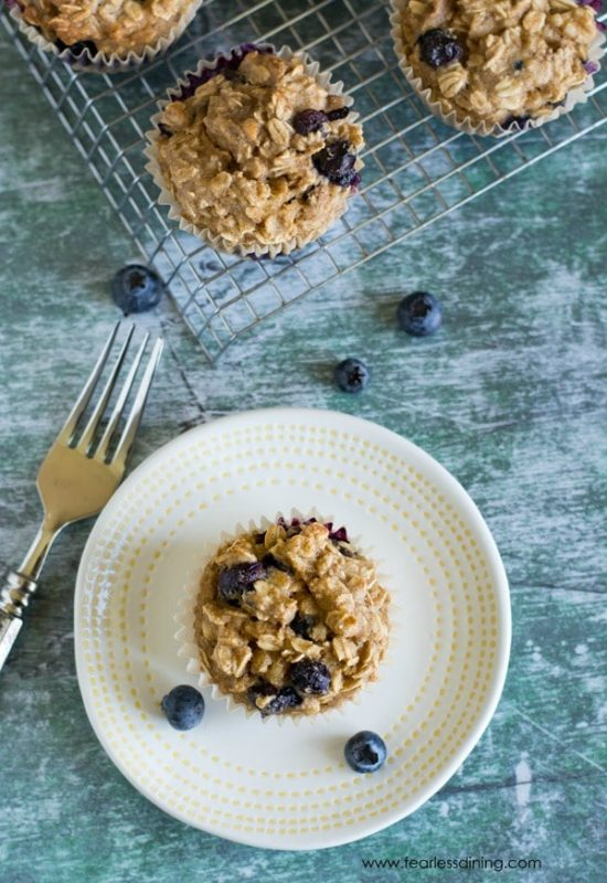 The top view of a blueberry muffin on a plate.