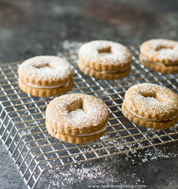 Gluten Free Gingerbread Linzer Cookies with Vanilla Frosting Centers on rack