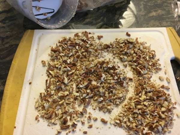 Chopping pecans on a cutting board