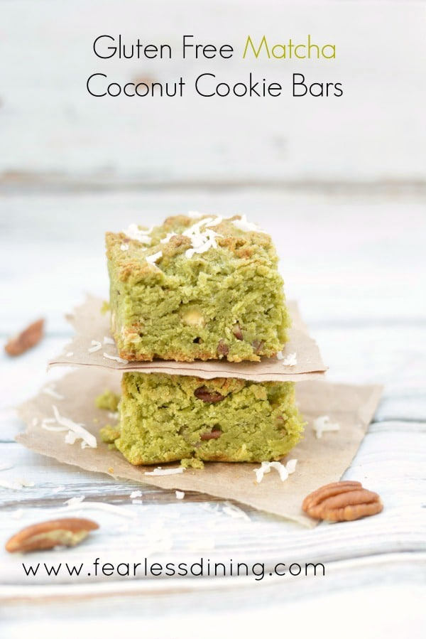 Two gluten free matcha coconut cookie bars stacked on top of each other.