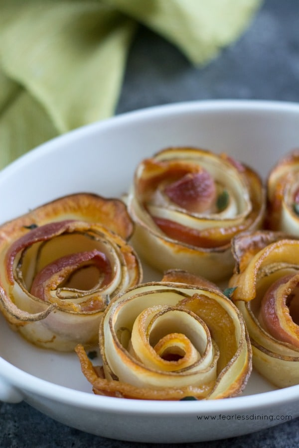 Rolled Potato Bacon Roses in a baking dish.