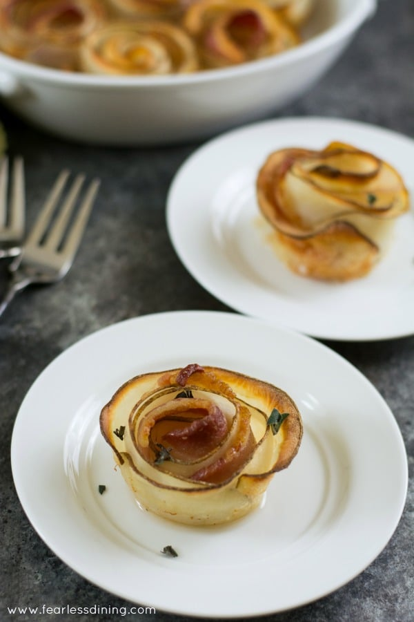 Roasted Potato Bacon Roses on plates.