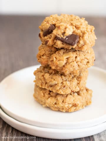 a stack of peanut butter oat cookies on a white plate