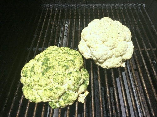 Two heads of cauliflower on the grill
