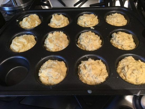 Corn bread batter in a muffin tin ready to bake