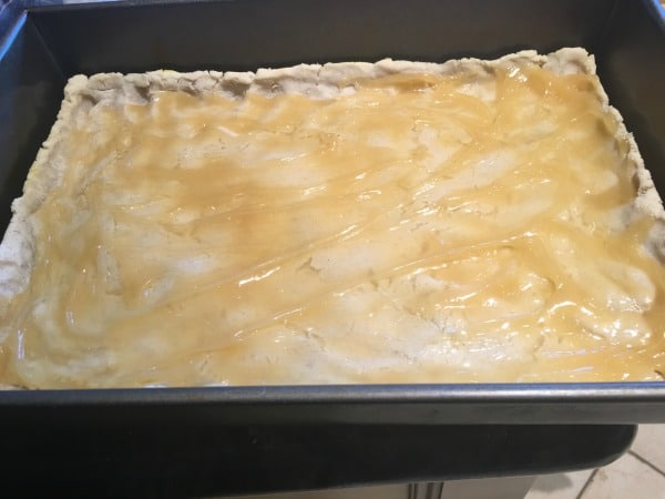 Lemon curd layer on top of the tart crust