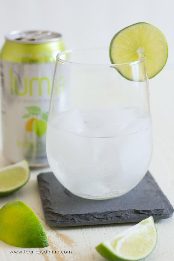 Luma premium lime soda in a glass with fresh limes