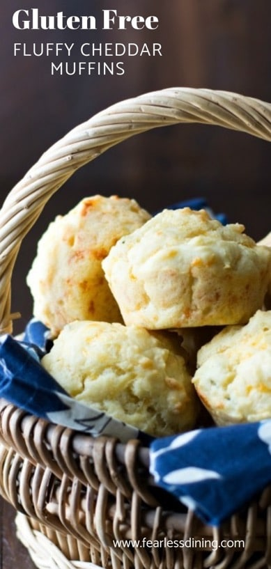 a basket full of light and fluffy cheddar herb muffins