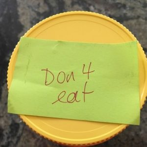 Jar of peanut butter with Don't Eat Me Sign