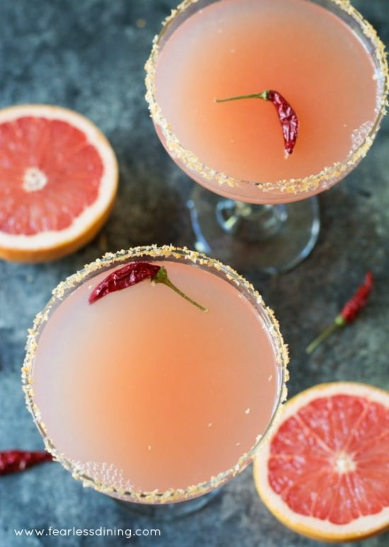 Easy pink grapefruit margaritas with a sriracha salt rim are perfect for a party.