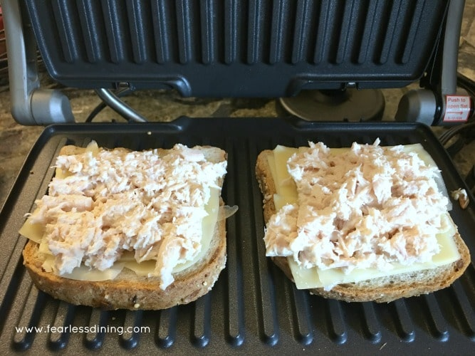 Tuna added to grilled cheese on panini machine