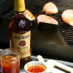 Four Roses Bourbon with apricot BBQ sauce and chicken grilling