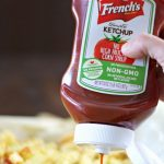 French's Ketchup being squirted onto French fries