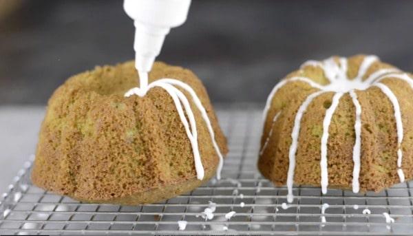 icing the mini bundt cakes