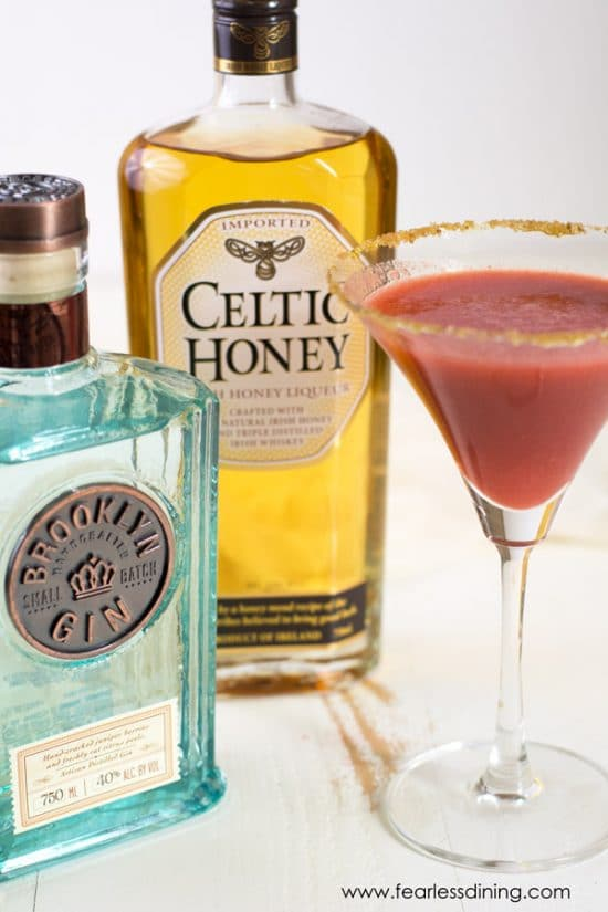 Bottles of Brooklyn Gin and Celtic Honey Liquor next to a martini glass