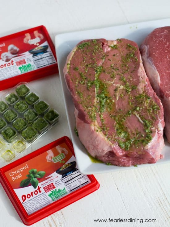 Steak marinating with garlic and basil