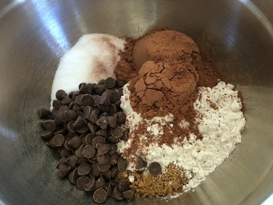 Edible cookie dough dry ingredients in a bowl. Sugar, cocoa, flour, sugar and chocolate chips!
