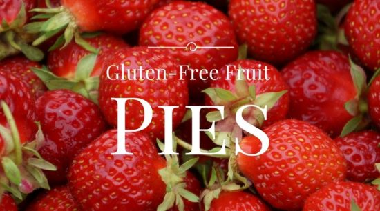 Strawberries with a gluten free fruit pies sign