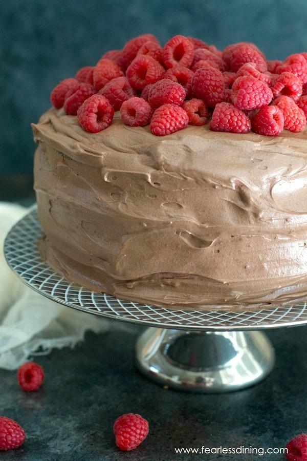 Fresh raspberries piled on a gluten free chocolate cake