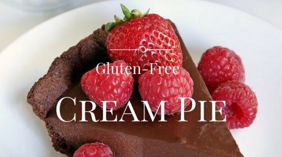 A slice of chocolate cream pie with fresh raspberries and strawberries