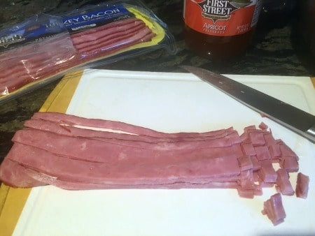 chopping turkey bacon on a cutting board