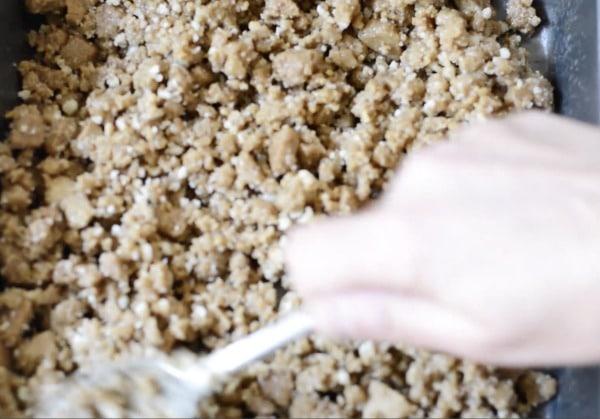 spreading the graham cracker crust