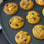 a muffin tin full of freshly baked pumpkin chocolate chip muffins