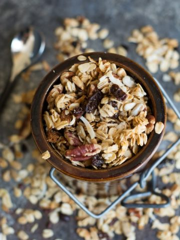 overhead image of a crock filled with a gluten free granola recipe for cinnamon granola