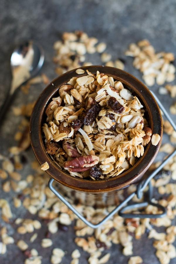 The top view of a container filled with homemade cinnamon granola
